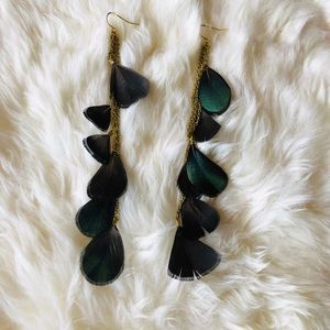 Feathered long earrings from Urban Outfitters